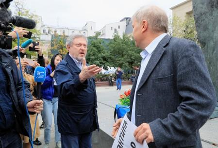 Russian opposition politicians Yavlinsky and Mitrokhin take part in a protest demanding authorities to allow opposition candidates to run in the upcoming local election and release people arrested for participation in opposition rallies, in Moscow