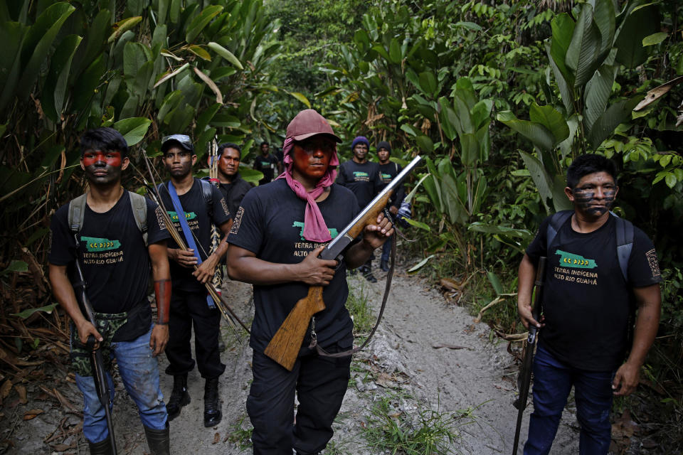 FILE - In this Sept. 8, 2020 file photo, Tenetehara Indigenous man Matuha Tembe, holds a shotgun as he patrols with the the Ka'Azar, or Forest Owners, on the Alto Rio Guama reserve in Para state, near the city of Paragominas, Brazil. President Jair Bolsonaro, a former Army captain who expresses nostalgia for Brazil's three decades of military rule, has said he wants to arm citizens to prevent a dictatorship from taking hold. (AP Photo/Eraldo Peres, File)