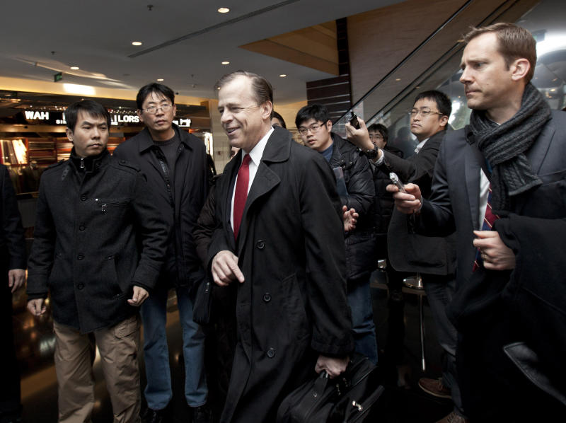 U.S. envoy for North Korean Affairs Glyn Davies, center, is surrounded by journalists after giving a statement to media at a hotel in Beijing, China, Thursday, Feb. 23, 2012. The U.S. and North Korea reopen nuclear talks on Thursday that will provide a glimpse into where Pyongyang's opaque government is heading after Kim Jong Il's death and test its readiness to dismantle nuclear programs for much-needed aid. (AP Photo/Andy Wong)
