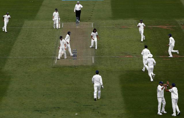 India's Ishant Sharma (C) celebrates his fifth wicket against New Zealand's BJ Watling during day one of the second international test cricket match at the Basin Reserve in Wellington, February 14, 2014. REUTERS/Anthony Phelps (NEW ZEALAND - Tags: SPORT CRICKET)