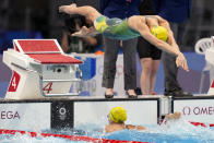 Emma McKeon of Australia, dives in for her leg of the women's 4x100m freestyle relay at the 2020 Summer Olympics, Sunday, July 25, 2021, in Tokyo, Japan. (AP Photo/Martin Meissner)