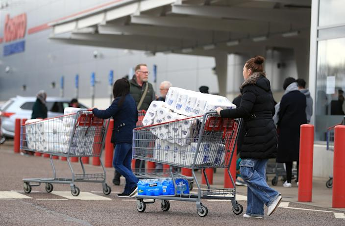 RETRANSMITTED ADDING LOCATION Customers stock up on toilet roll at Costco in Leicester as the Chancellor is to unveil an emergency package aimed at protecting workers' jobs and wages as they face hardship in the fight against the coronavirus pandemic. (Photo by Mike Egerton/PA Images via Getty Images)