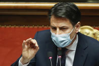 Italian Prime Minister Giuseppe Conte speaks during his final address at the Senate prior to a confidence vote, in Rome, Tuesday, Jan. 19, 2021. Italian Premier Giuseppe Conte fights for his political life with an address aimed at shoring up support for his government, which has come under fire from former Premier Matteo Renzi's tiny but key Italia Viva (Italy Alive) party over plans to relaunch the pandemic-ravaged economy. (Yara Nardi/pool photo via AP)