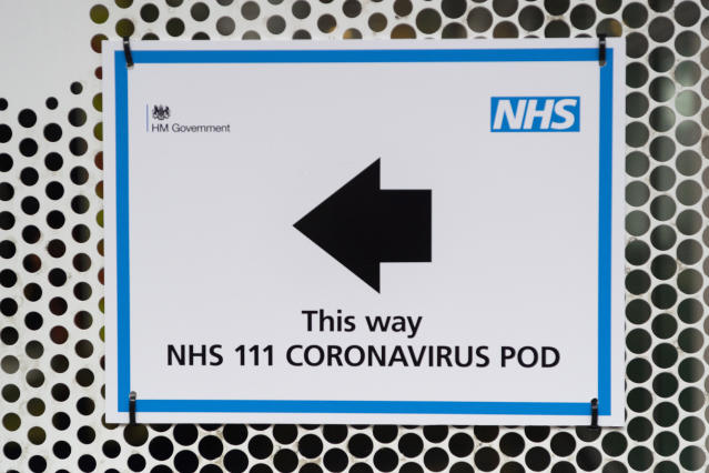 A sign directing patients to a National Health Service 111 Coronavirus Pod. (Getty)