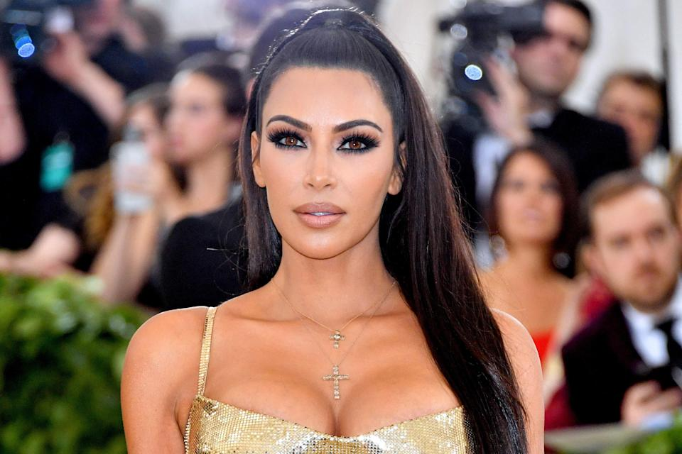 Kim Kardashian and Mario Dedivanovic used golden colored contacts to complement her '90s-inspired KKW Beauty Met Gala 2018 glam.