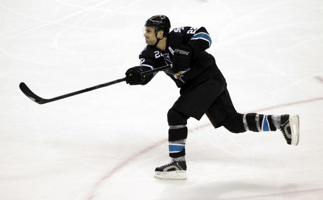 FILE - In this Jan. 2, 2014 file photo, San Jose Sharks' Dan Boyle (22) shoots against the Edmonton Oilers during an NHL hockey game in San Jose, Calif. NHL teams can begin making deals with free agents Tuesday, July 1, 2014. (AP Photo/Marcio Jose Sanchez, File)
