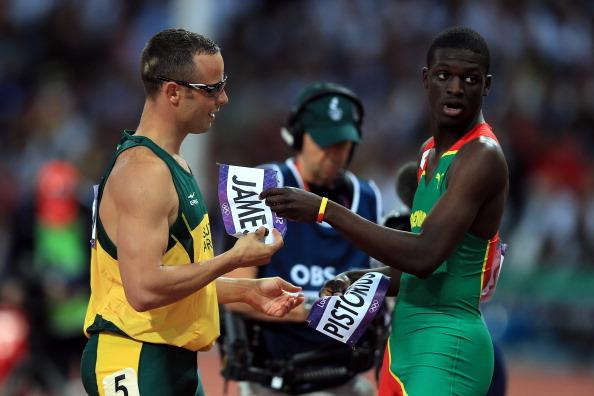 LONDON, ENGLAND - AUGUST 05:  Oscar Pistorius (L) of South Africa exchanges bibs with Kirani James (R) of Grenada after the Men's 400m semifinal on Day 9 of the London 2012 Olympic Games at the Olympic Stadium on August 5, 2012 in London, England.  (Photo by Phil Walter/Getty Images)