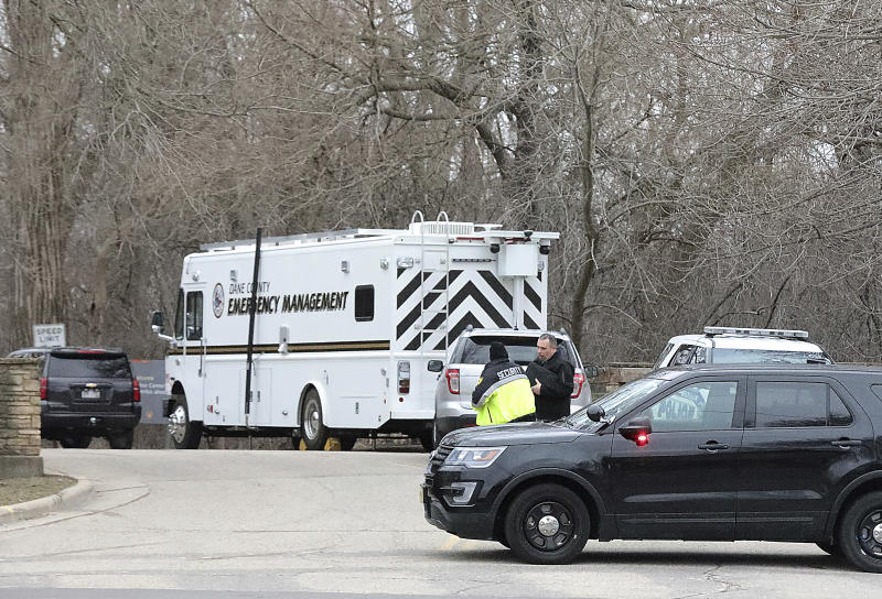 Vehicles from the Madison Police Department, Dane County Sheriff's Office and the University of Wisconsin Police Department are stationed at the entrance the UW-Arboretum in Madison, Wis. as law enforcement personnel investigate a double homicide Tuesday, March 31, 2020. (John Hart/Wisconsin State Journal via AP)