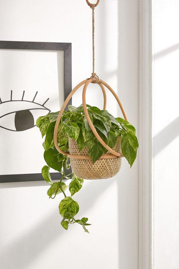 """<h2>Urban Outfitters Margot Hanging Planter</h2> <br>Upgrade your living space with a hanging pot crafted from a mix of woven rattan materials, corded bindings, and wooden rings that will easily complement a variety of interiors.<br><br><strong>Urban Outfitters</strong> Margot Hanging Planter, $, available at <a href=""""https://www.urbanoutfitters.com/shop/margot-7-hanging-planter"""" rel=""""nofollow noopener"""" target=""""_blank"""" data-ylk=""""slk:Urban Outfitters"""" class=""""link rapid-noclick-resp"""">Urban Outfitters</a><br>"""