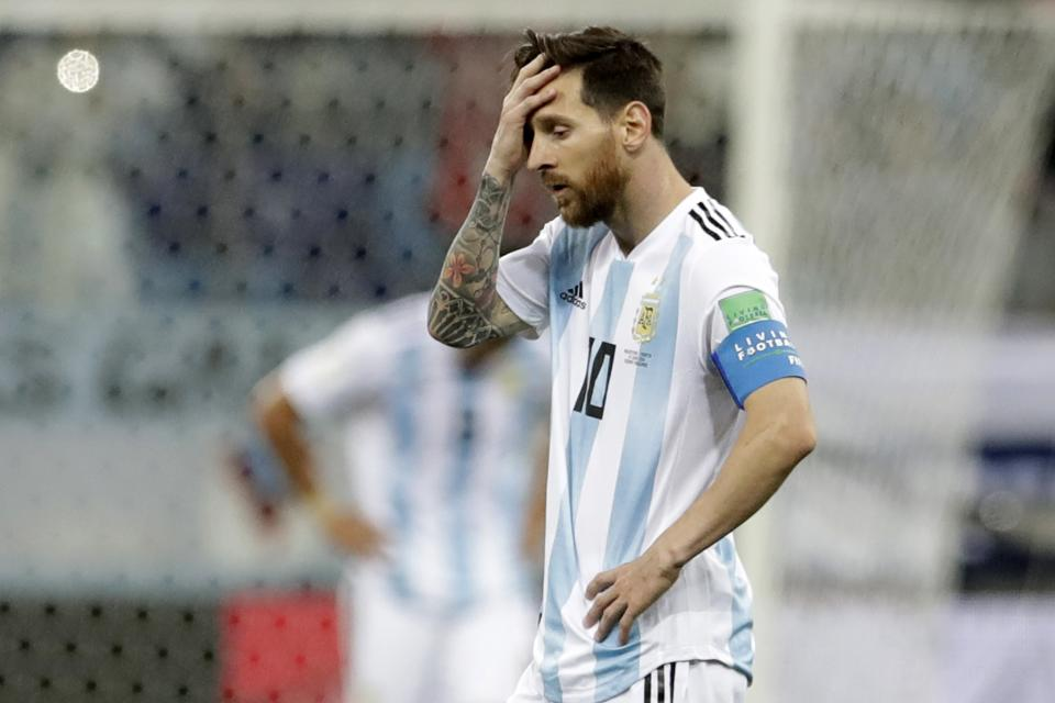 Argentina's Lionel Messi reacts after the third goal by Croatia during the group D match between Argentina and Croatia. (AP)