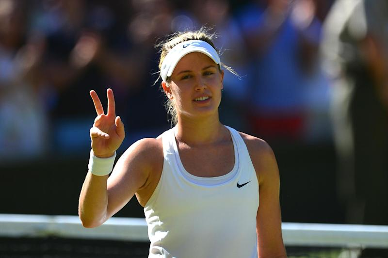 Canada's Eugenie Bouchard celebrates winning her women's singles semi-final match against Romania's Simona Halep at the 2014 Wimbledon Championships in southwest London, on July 3, 2014