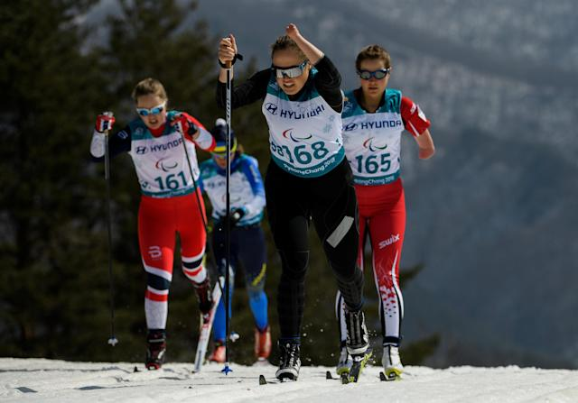 Natalia Bratiuk NPA (centre) races ahead of Vilde Nilsen NOR (left) and Brittany Hudak CAN (right) in the Cross-Country Skiing Standing Women's 1.5km Sprint Classic Semifinal at the Alpensia Biathlon Centre. The Paralympic Winter Games, PyeongChang, South Korea, Wednesday 14th March 2018. OIS/IOC/Thomas Lovelock/Handout via REUTERS