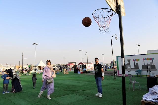"Amirah al-Turkistani, a graphic design lecturer at Jeddah International College, plays basketball during the Rajana Ayamona festival in Jeddah, Saudi Arabia, February 1, 2018. REUTERS/Reem Baeshen SEARCH ""BAESHEN WOMEN"" FOR THIS STORY. SEARCH ""WIDER IMAGE"" FOR ALL STORIES."