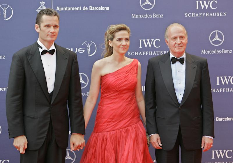 FILE - In this May 22, 2006 file photo, Spain's King Juan Carlos arrives with his daughter, Princess Cristina, and her husband, Inaki Urdangarin, for the Laureus World Sports Awards in Barcelona, Spain. Urdangarin is accused of having used his position to embezzle several million dollars in public contracts assigned to a nonprofit foundation he set up. The corruption scandal is contributing to the public's diminishing respect for the monarchy. With the 75-year-old king's reputation in decline and several health scares recently, Juan Carlos and the Spanish monarchy are facing one of their biggest crises ever. The last time Juan Carlos appeared in public in front of thousands of people, he was greeted by persistent heckling and whistling never before seen during his reign of nearly four decades. (AP Photo/Jasper Juinen, File)