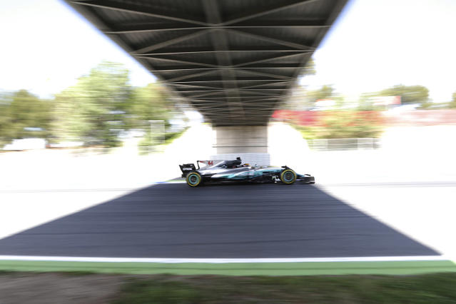 <p>Mercedes driver Lewis Hamilton of Britain steers his car during the third practice session for the Spanish Formula One Grand Prix at the Barcelona Catalunya racetrack in Montmelo, Spain, May 13, 2017. The F1 race will be held on Sunday. (Photo: Emilio Morenatti/AP) </p>