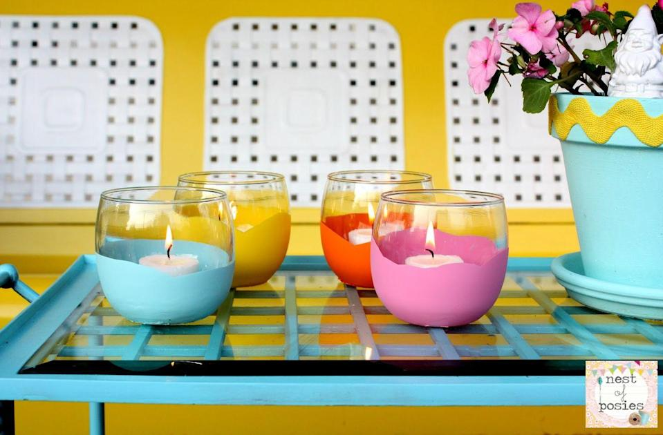 """<p>It doesn't get simpler (or cheaper!) than this. Dip dollar-store candle holders in colorful acrylic paint for a peppy tablescape.</p><p><a class=""""link rapid-noclick-resp"""" href=""""https://www.amazon.com/Apple-Barrel-Acrylic-2-Ounce-PROMOABI/dp/B00ATJSD8I/?tag=syn-yahoo-20&ascsubtag=%5Bartid%7C10055.g.3620%5Bsrc%7Cyahoo-us"""" rel=""""nofollow noopener"""" target=""""_blank"""" data-ylk=""""slk:SHOP ACRYLIC PAINTS"""">SHOP ACRYLIC PAINTS</a></p><p><em><a href=""""http://www.nestofposies-blog.com/2012/06/dipped-votives-dollar-store-craft-idea/"""" rel=""""nofollow noopener"""" target=""""_blank"""" data-ylk=""""slk:Get the tutorial at Nest of Posies »"""" class=""""link rapid-noclick-resp"""">Get the tutorial at Nest of Posies »</a></em> </p>"""