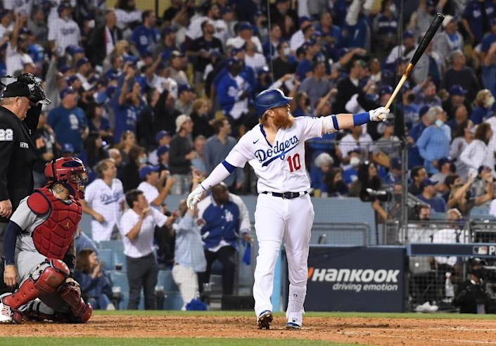 Los Angeles Dodgers' Justin Turner looks up after hitting a solo home run to tie the game