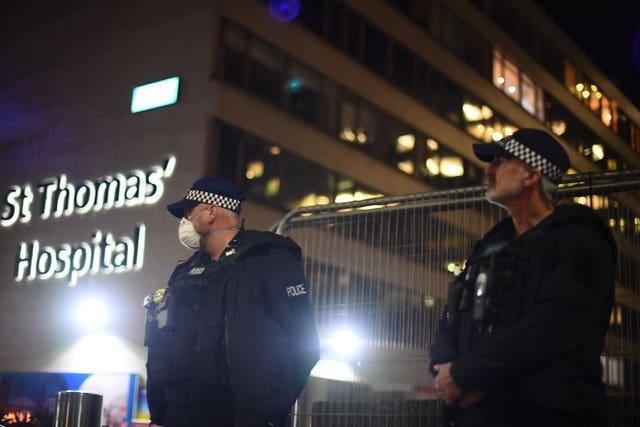 Police officers outside St Thomas' Hospital in central London while Prime Minister Boris Johnson was in intensive care (Victoria Jones/PA)