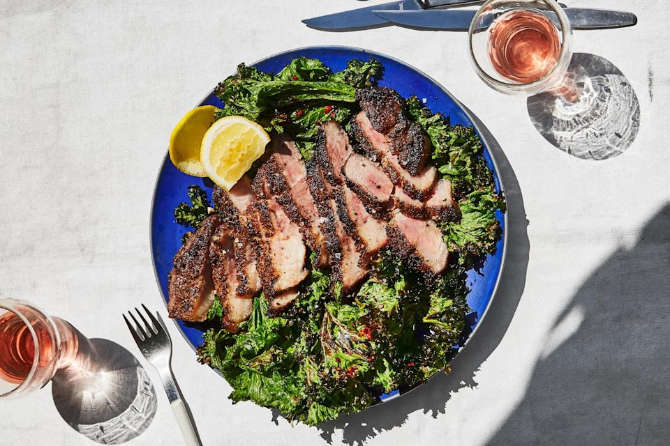 """Like rib eye, pork shoulder has lots of intramuscular fat, and like strip steak, it has satisfying chew. Slicing it thickly and grilling it swiftly maximizes the enjoyment of both. <a href=""""https://www.epicurious.com/recipes/food/views/pork-shoulder-steaks-with-grilled-mustard-greens?mbid=synd_yahoo_rss"""" rel=""""nofollow noopener"""" target=""""_blank"""" data-ylk=""""slk:See recipe."""" class=""""link rapid-noclick-resp"""">See recipe.</a>"""
