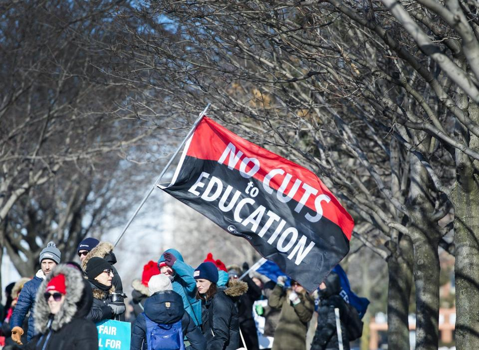 """<span class=""""caption"""">Thousands of teachers from the Peel District School Board hold a one-day strike in Mississauga, Ont., in February 2020.</span> <span class=""""attribution""""><span class=""""source"""">THE CANADIAN PRESS/Nathan Denette </span></span>"""