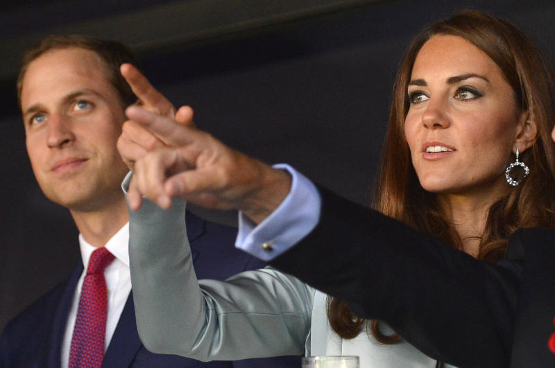 Britain's Prince William, the Duke of Cambridge, left, and his wife Britain's Catherine, Duchess of Cambridge wait for the beginning of the opening ceremony of the London 2012 Summer Olympic Games in the Olympic Stadium in London, Friday, July 27, 2012. (AP Photo/Toby Melville, pool)