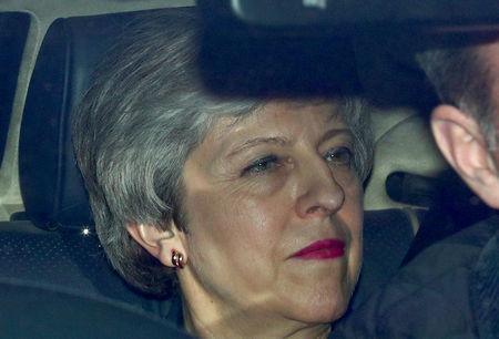 Britain's Prime Minister Theresa May is seen in a car outside the Houses of Parliament in London, Britain, March 27, 2019. REUTERS/Hannah McKay