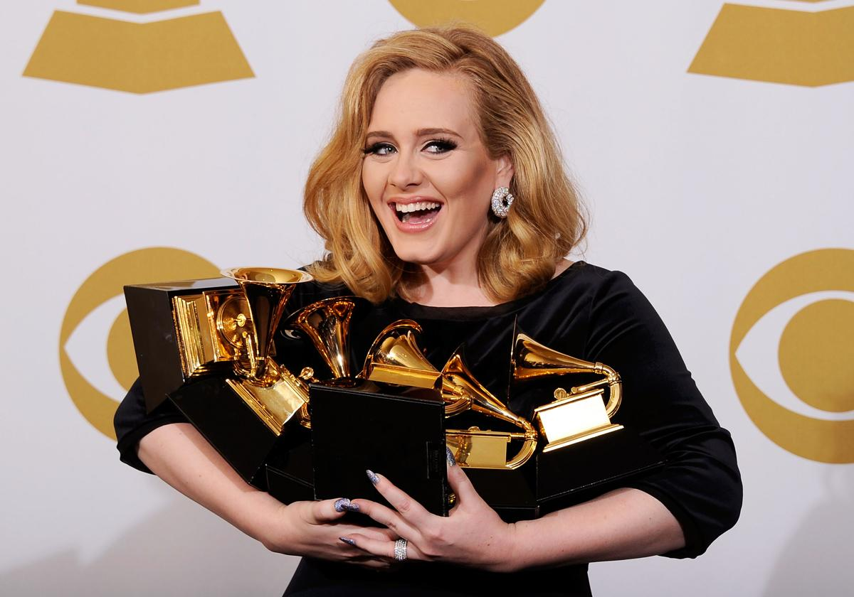 """Singer Adele, winner of the GRAMMYs for Record of the Year for """"Rolling In The Deep"""", Album of the Year for """"21"""", Song of the Year for """"Rolling In The Deep"""", Best Pop Solo Performance for """"Someone Like You"""", Best Pop Vocal Album for """"21"""" and Best Short Form Music Video for """"Rolling In The Deep"""", poses in the press room at the 54th Annual GRAMMY Awards at Staples Center on February 12, 2012 in Los Angeles, California.  (Photo by Kevork Djansezian/Getty Images)"""