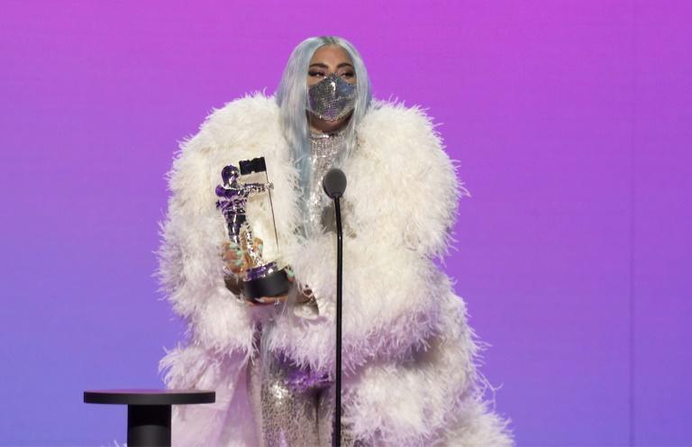 """Musician Lady Gaga (pictured August 2020 during the MTV VMAs) joked that she was """"GLAD TO BE LIVING RENT FREE"""" in US President Donald Trump's head"""