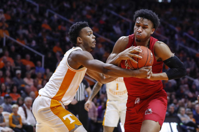 Jacksonville State forward Jacara Cross (2) drives for a shot as Tennessee guard Josiah-Jordan James (5) defends during the second half of an NCAA college basketball game Saturday, Dec. 21, 2019, in Knoxville, Tenn. Tennessee won 75-53. (AP Photo/Wade Payne)