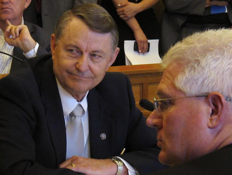 Kansas state Rep. Richard Carlson, a St. Marys Republican, the House's lead negotiator on tax issues, follows discussions about pushing for less aggressive income tax cuts than ones previously approved by legislators, Tuesday, May 15, 2012, at the Statehouse in Topeka, Kan. To his right is Sen. Pat Apple, a Louisburg Republican. (AP Photo/John Hanna)