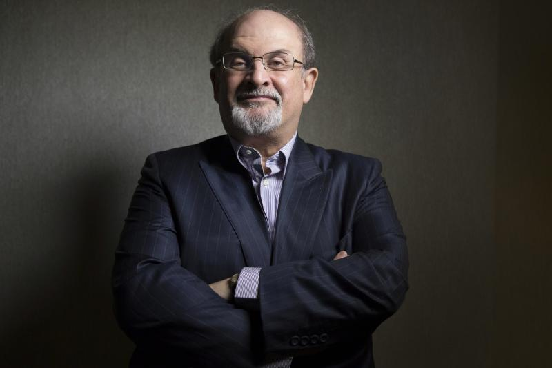 "FILE - This Sept. 8, 2012 file photo shows author Salman Rushdie posing for a photo as he promotes the movie ""Midnight's Children"" during the 2012 Toronto International Film Festival in Toronto. Rushdie is dismissing the latest threat against his life as just talk. ""This was essentially one priest in Iran looking for a headline,"" the author of ""The Satanic Verses"" said Tuesday, Sept. 18, as he spoke at a Barnes & Noble in New York. Iran's Ayatollah Ruhollah Khomeini in 1989 declared Rushdie's novel was blasphemous and called for his death. A semi-official Iranian religious foundation headed by Ayatollah Hassan Saneii has raised the bounty for Rushdie from $2.8 million to $3.3 million after recent protests against an anti-Islamic film that helped lead to riots around the Middle East.  (AP Photo/The Canadian Presss, Chris Young, file)"