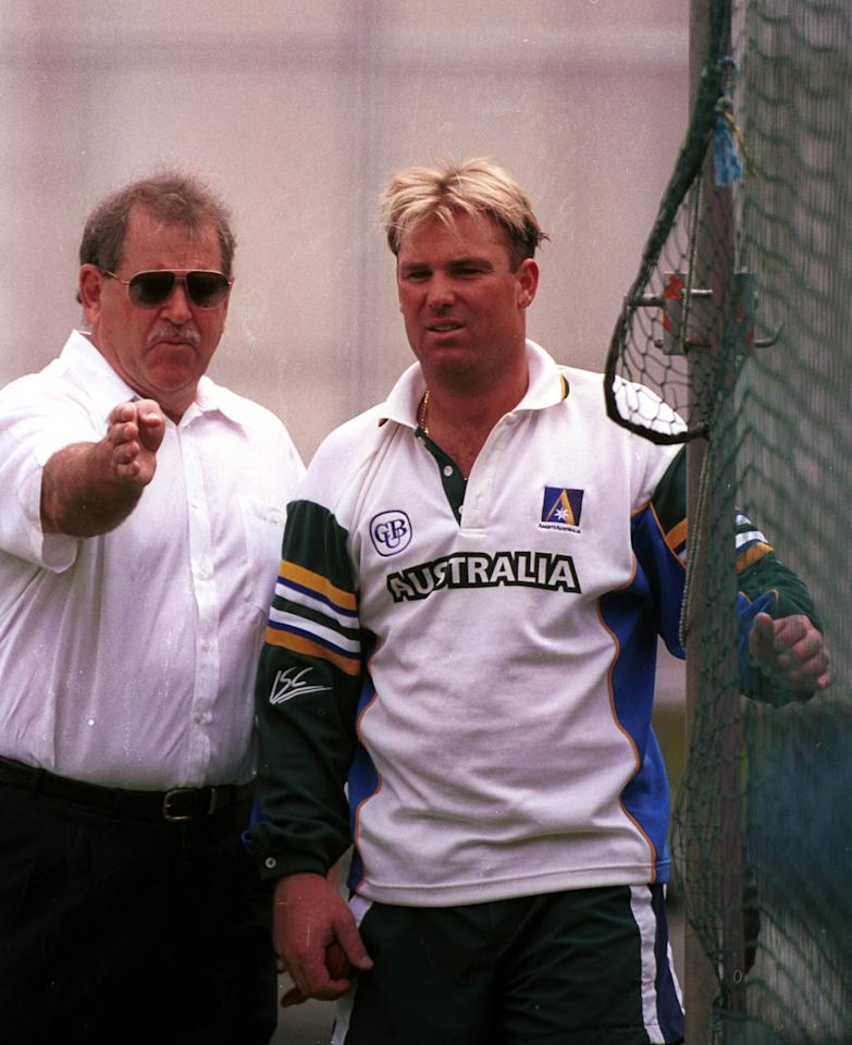 4 Nov 1999:  Leg spin bowler Shane Warne of Australia on the right listens to advice  from his bowling coach Terry Jenner  during net practice ahead of the First Test Match against Pakistan at The Gabba, Brisbane, Australia. Mandatory Credit: Jack Atley/ALLSPORT