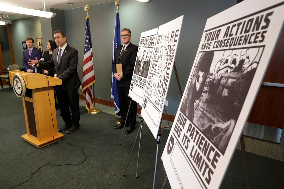An FBI special agent discusses charges against four alleged members of the neo-Nazi group Atomwaffen Division for cyberstalking and mailing threatening communications to journalists. Some of the threatening posters that were sent to the journalists are displayed. (Photo: ASSOCIATED PRESS)