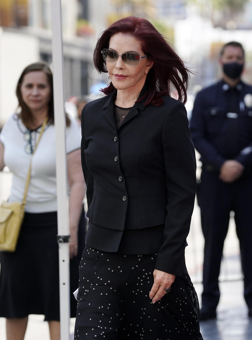 Priscilla Presley appears at a ceremony honoring television producer Nigel Lythgoe with a star on the Hollywood Walk of Fame, Friday, July 9, 2021, in Los Angeles. (AP Photo/Chris Pizzello)