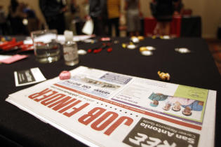 In this Oct. 4, 2011 photo, prospective employees and vendors attend a job fair, in San Antonio.: Credit AP