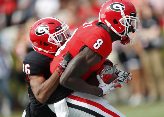 Georgia receiver Riley Riddley (8) can't hang on to a pass as Tyrique McGhee (26) defends during the first half of the G day inter squad spring football game Saturday, April 21, 2018, in Athens, Ga. Riddley was shaken up on the play and left the game. (AP Photo/John Bazemore)
