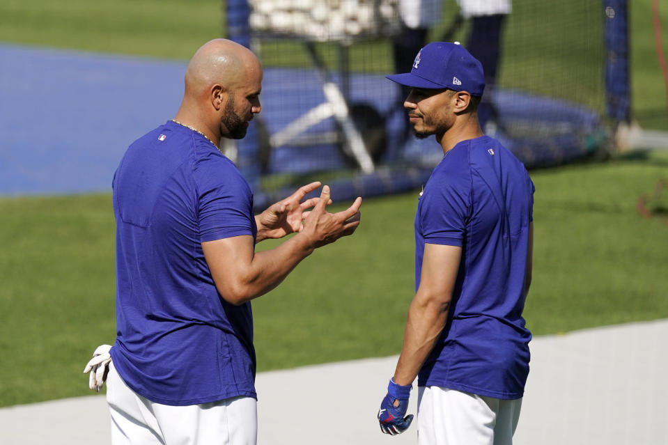 Los Angeles Dodgers first baseman Albert Pujols, left, talks with right fielder Mookie Betts prior to a baseball game against the Arizona Diamondbacks Monday, May 17, 2021, in Los Angeles. (AP Photo/Mark J. Terrill)