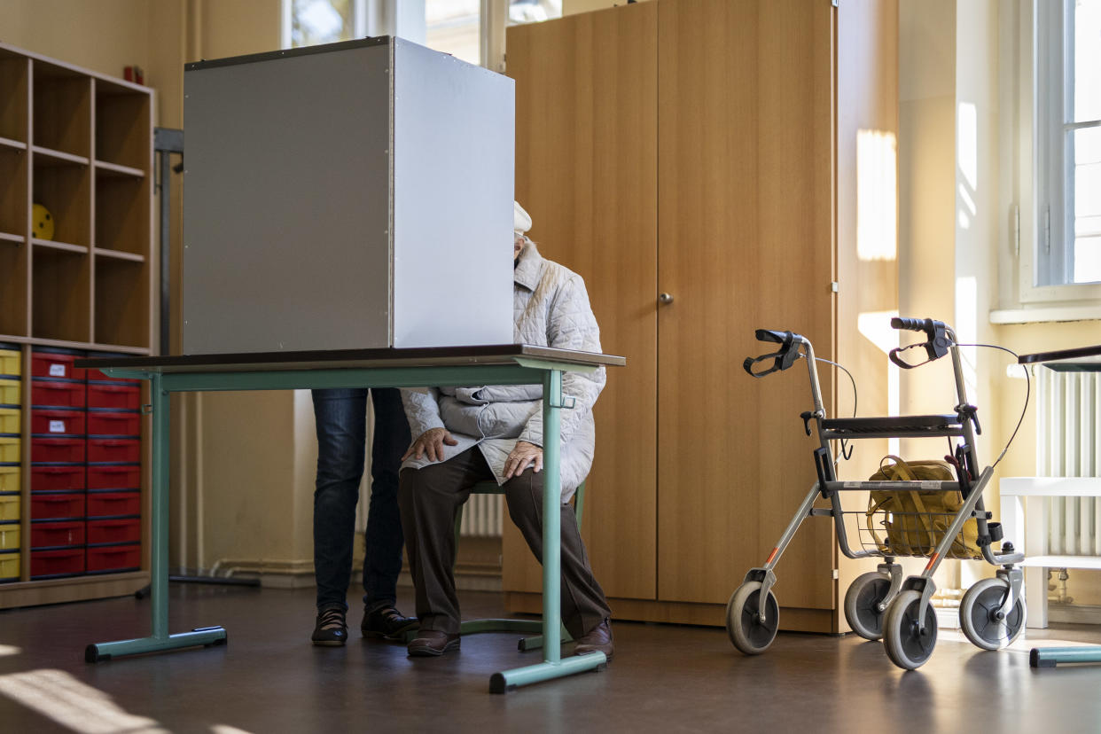 POTSDAM, GERMANY - SEPTEMBER 26: An elder woman is pictured in a poll site for the federal election on September 26, 2021 in Potsdam, Germany. After 16 years chancellorship of Angela Merkel it is going to become a head-on-head between Olaf Scholz (not pictured), chancellor candidate for the SPD, and Armin Laschet (not pictured), prime minister of the German state of North Rhine-Westphalia and Chairman of the CDU. (Photo by Florian Gaertner/Photothek via Getty Images)