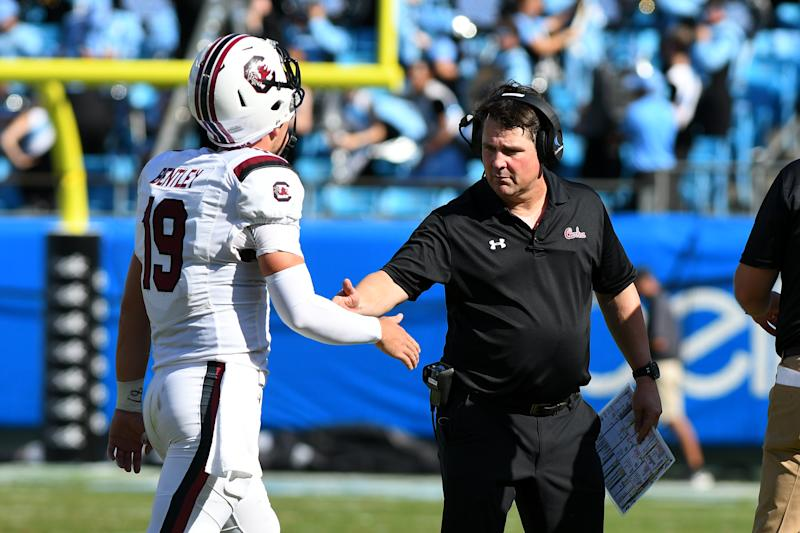 CHARLOTTE, NC - AUGUST 31:South Carolina Gamecocks head coach Will Muschamp high fives South Carolina Gamecocks quarterback Jake Bentley (19) for a score as he walks off the field during the Belk College Kickoff game between the South Carolina Gamecocks and the North Carolina Tar Heels on August 31, 2019 at Bank of America Stadium in Charlotte,NC. (Photo by Dannie Walls/Icon Sportswire via Getty Images)