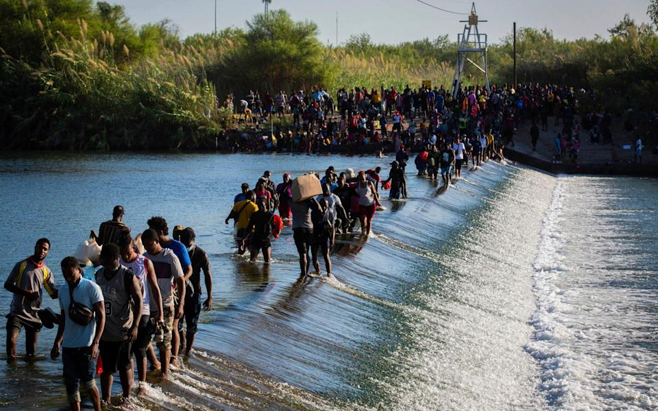 Haiti migrants waiting to get access to the United States cross the Rio Grande - Marie D. De Jesa/Houston Chronicle