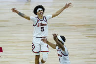 Illinois guard Andre Curbelo (5) and guard Trent Frazier (1) celebrate after defeating Ohio State in overtime in an NCAA college basketball championship game at the Big Ten Conference tournament, Sunday, March 14, 2021, in Indianapolis. (AP Photo/Michael Conroy)