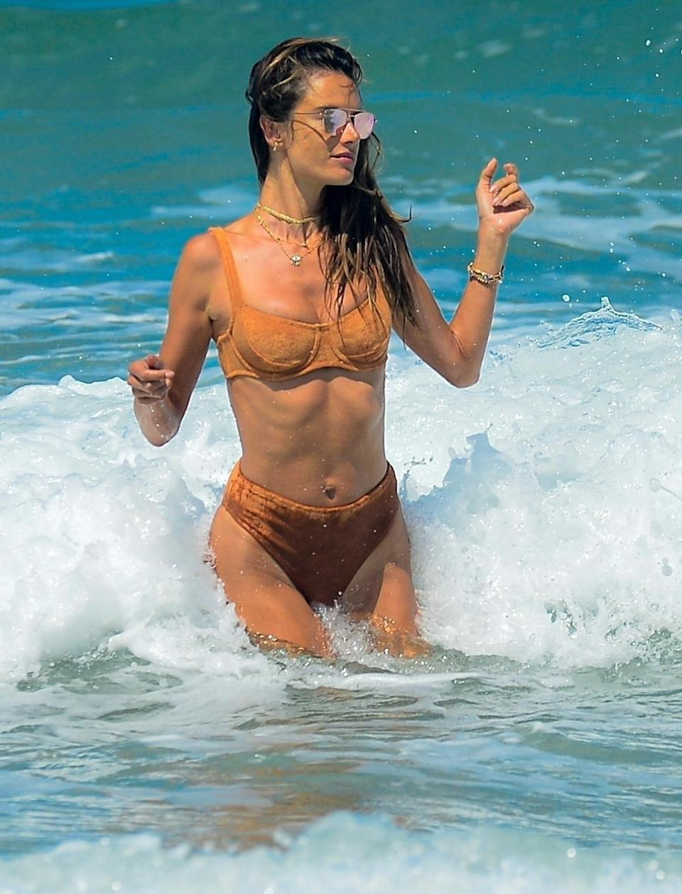 <p>Alessandra Ambrósio continues her visit to Brazil on Friday with a trip to the beach in Florianópolis.</p>