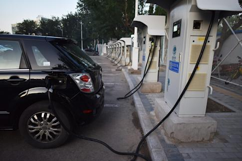 A BYD electric car at a charging station in Beijing on September 11, 2017. Photo: Agence France-Presse