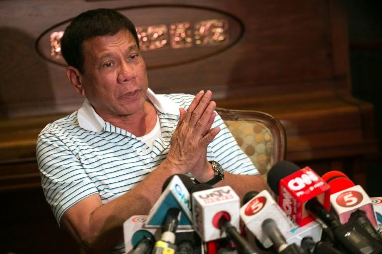 Philippines' president-elect Rodrigo Duterte speaks during a press conference in Davao City, on May 23, 2016