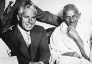 (Original Caption) Mahatma Gandhi, spiritual leader of India's millions of people, and Charles Chaplin, the American movie comedian, met recently in London and chatted for some time. Gandhi professed that he had not heard of Chaplin, but his associates assured him of the comedian's popularity and the meeting was arranged. They are shown here together at the residence of Dr. Katial in the London East End. Undated photograph. (Photo by George Rinhart/Corbis via Getty Images)