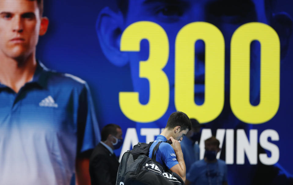 Novak Djokovic of Serbia leaves after losing his semifinal match against Dominic Thiem of Austria at the ATP World Finals tennis tournament at the O2 arena in London, Saturday, Nov. 21, 2020. (AP Photo/Frank Augstein)