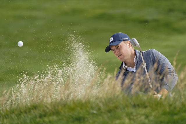 Jordan Spieth hits out of the bunker on the 10th hole during a practice round for the U.S. Open Championship golf tournament Wednesday, June 12, 2019, in Pebble Beach, Calif. (AP Photo/David J. Phillip)