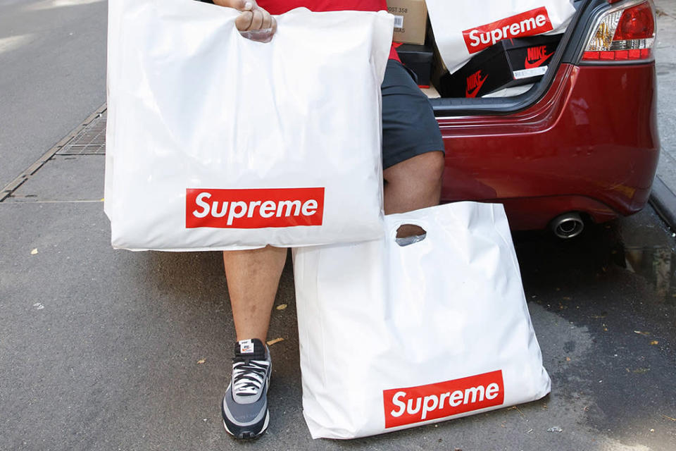 Supreme reseller with several bags from the store. - Credit: MEGA
