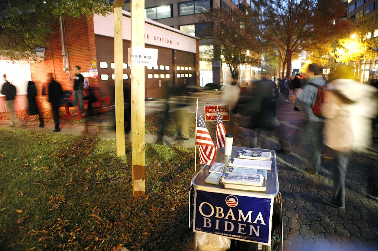 People queue in Arlington, Virginia, where Obama won four years ago, the first time a Democrat won since 1964 (Rex)