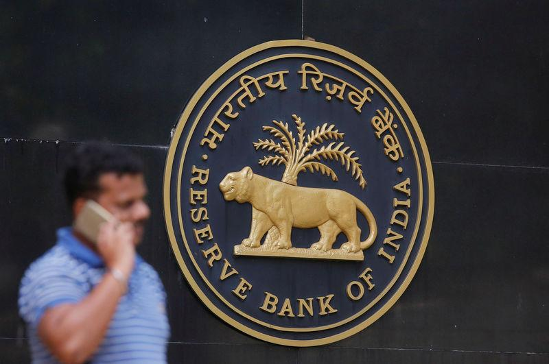 FILE PHOTO: A man speaks on his mobile phone outside the RBI headquarters in Mumbai